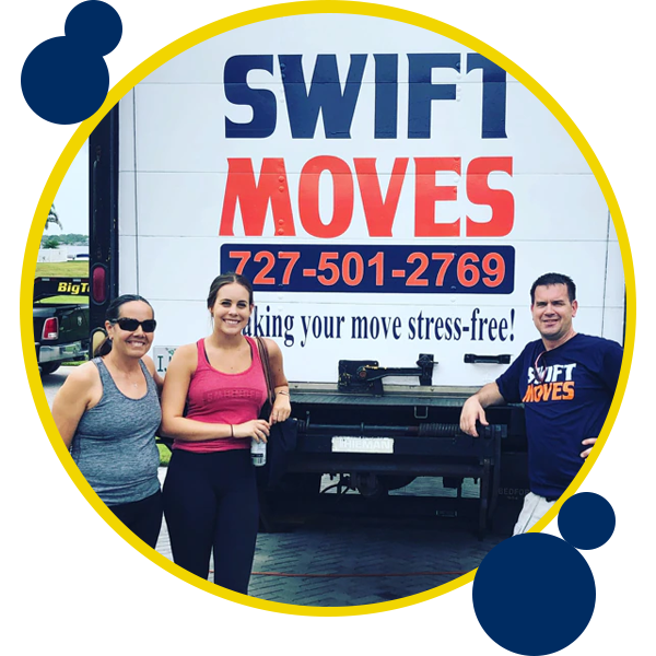 Image of Swift Moves crew standing behind moving truck